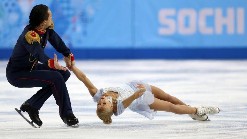Tatiana Volosozhar şi Maxim Trankov - Foto: zastavki.com
